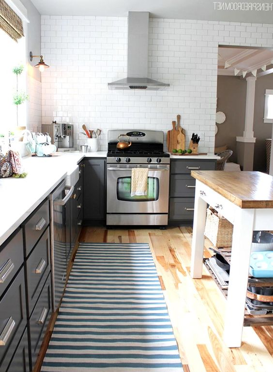 Gray cabinets, white counters, no overhead cupboards on far wall ...