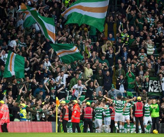 Leigh Griffiths (blocked) and team-mates celebrate the striker's penalty with the adoring fans