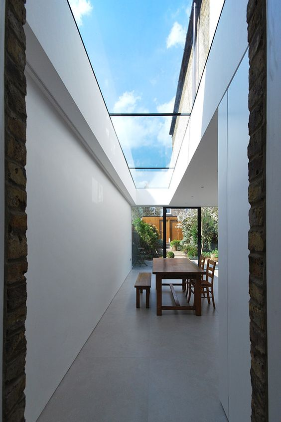 Contemporary minimalist Kitchen , porcelain tiles, frameless glass rooflight Queens Park North London NW6 Extension Project
