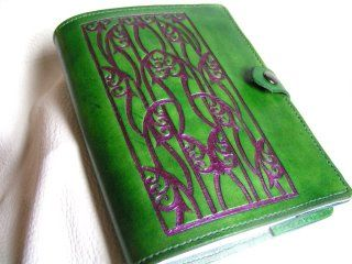 Tooled leather journal cover by Rebecca Schooley, the design came from 489 Ornaments and Designs, I used the inverted carving technique for the tooling.
