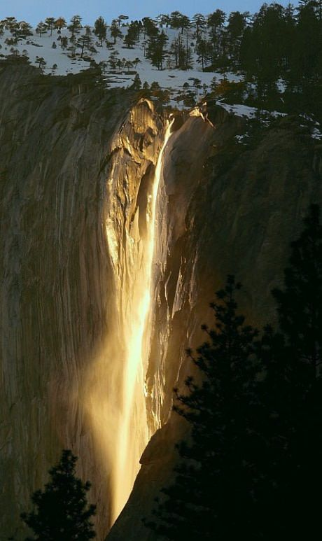 Once every year, the sun hits Yosemite's waterfalls just right to make it light…