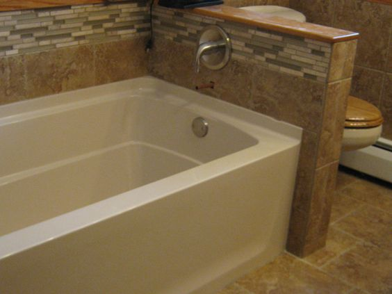 Sterling Ensemble Acrylic Tub With Custom Tile Wainscoting And Tub Splash Danze Fixtures Acrylic Tub Custom Tiles Bathrooms Remodel