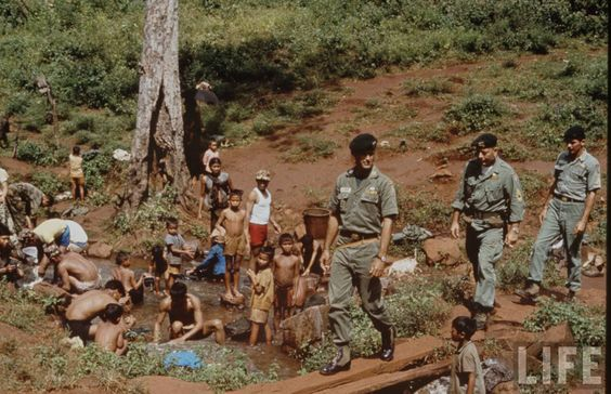 A series by Larry Burrows taken in 1964 and showing some Special Forces working with a CIDG or MIKE unit.