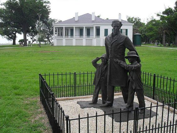"Confederate States of America Statue of Jefferson Davis at ""Beauvoir"" with his son Joe and adopted black son Jim Limber.:"
