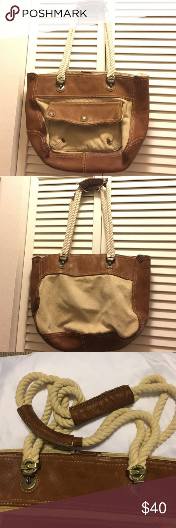 Gap Purse with rope straps Brown leather and tan canvas purse with braided rope straps. Good condition,very roomy inside. It will make someone happy... GAP Bags Shoulder Bags