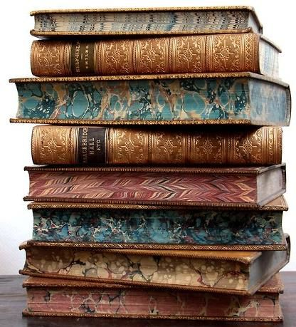 Old books with marbled edge paper. E-books, while they have their merits, just cannot hold a candle to the real thing.: