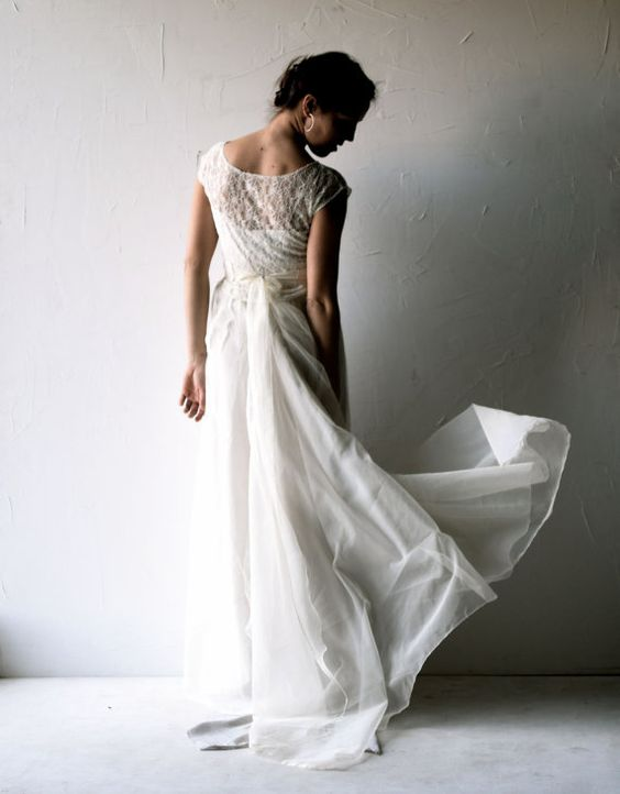 A delicate, retro style wedding gown, where the main focus is on the quality fabrics, and the balance of the proportions and textures.  The delicately