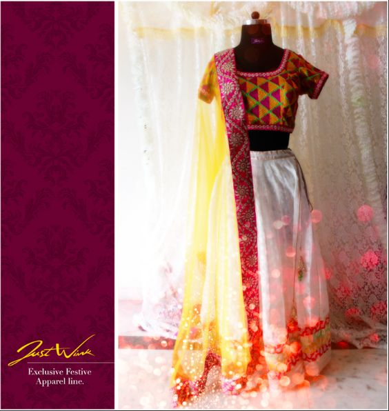 JW's Beautifully bright phulkari embroidered choli with pure off-white chanderi lehenga and mango yellow dupatta looks fab when worn normally or as a half saree. Its complete fresh take on ethnic lehenga choli.   visit us at : www.facebook.com/justwinker