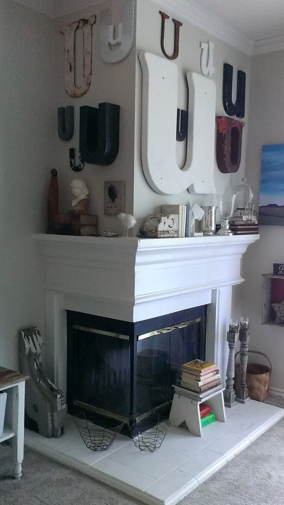 Artfully cluttered fireplace with a collection of U's.