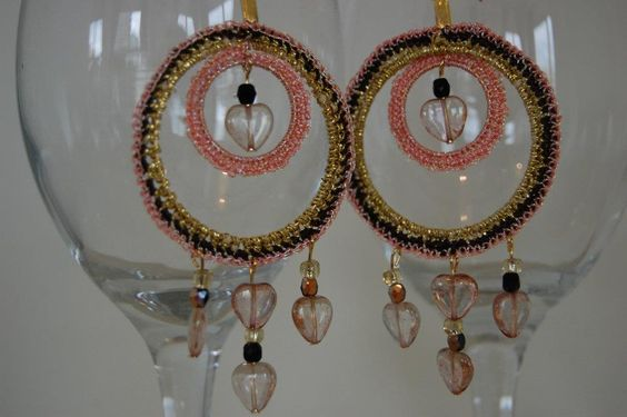 Be Mine Earrings - ML138E  Perfect for a Valentine's Day gift. Romantic, hippy earrings with cute little pink hearts, dark brown crystals, and gold-colored glass beads.Crocheted with metallic gold thread, dark brown thread, and metallic pink thread. Gold-plated earring base.  $57.00  http://www.melissajewelrydesign.com/earrings/be-mine