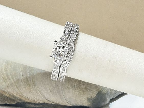 1.50CTW princess cut and round diamond engagement ring and matching diamond contour wedding band both set in 14KT white gold. *Center diamond is 0.75CT princess cut*  Sale Price: $5,599.00