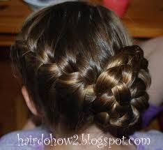 Side French braid and into a bun...very cute. Going to try to do this