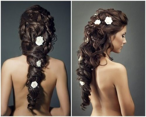 Long brown curly braid with white flowers