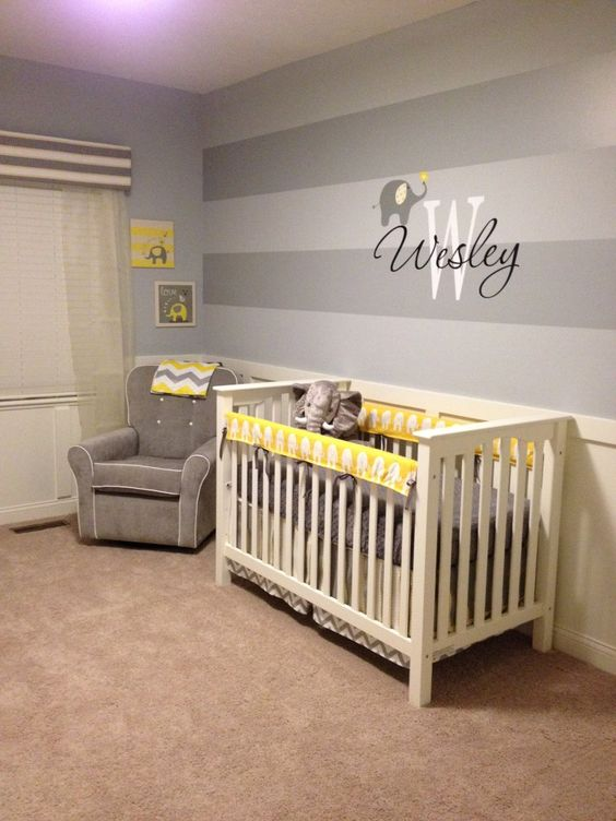 The two-toned gray stripes make a huge impact on this #nursery accent wall.