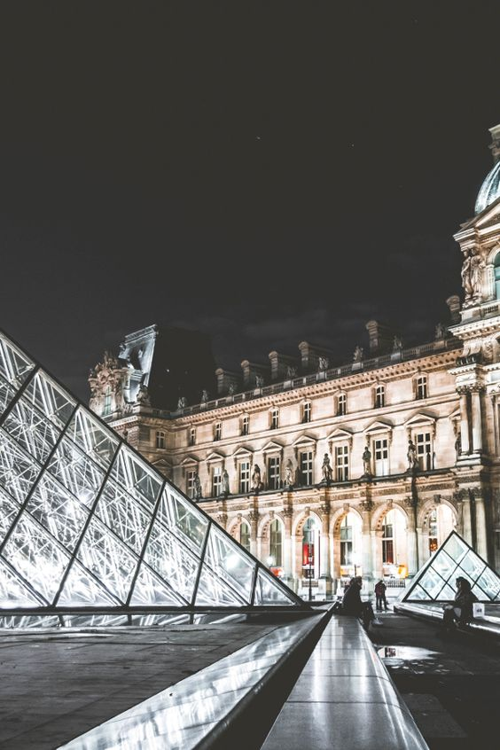 Visit the Louvre Museum in Paris and admire its amazing architecture.