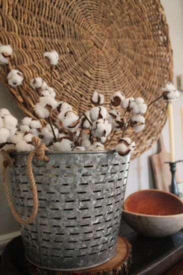 Olive bucket from Target and cotton stems. Combine metal, wicker and wood for interesting texture to any display.