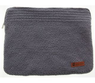 krochet kids laptop sleeve--  crocheted by Ugandan women, and also utilizes materials sourced from local vendors.