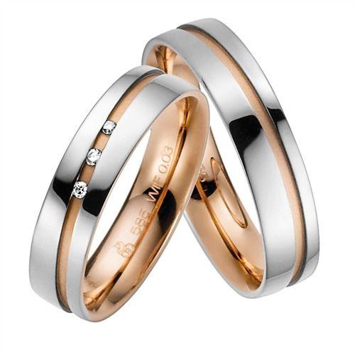 Exklusive Trauringe der Firma Rauschmayer aus Weißgold und Rotgold. Die Ringe gehören der Kollektion Sandwich zwei an. Sie sind 5mm breit und besitzen eine Rotgold sandmatte sowie glänzend Oberfläche. Der Damenring wird zudem von 3 Brillanten geziert.  Wunderschön!!