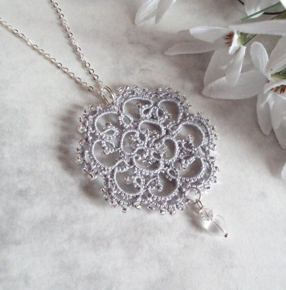 "deviantART: Lace tatted pendant ""Rosetta"" by TataniaRosa  pattern link is here on deviantArt."