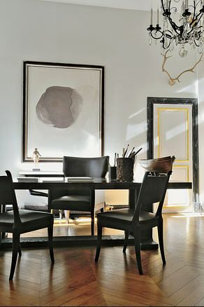 The dining room, with a dogwood and ash table by Liaigre and a painting by Vincent Gassin.: