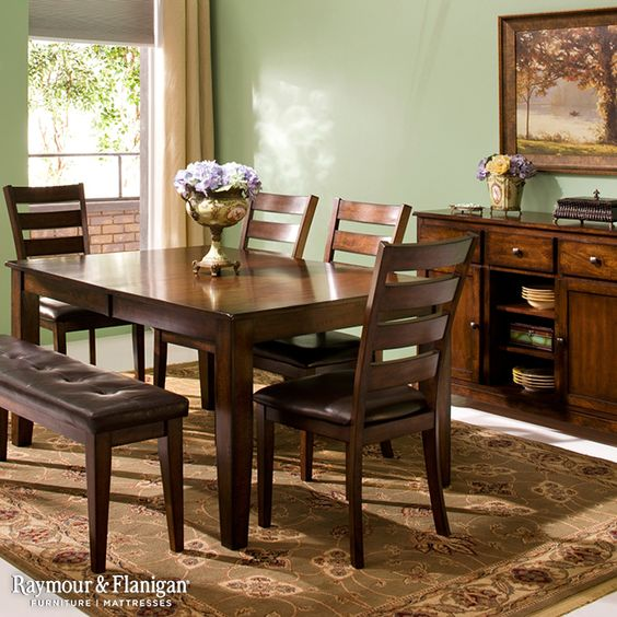 The rustic touches and distressing nature of this Kona Dining Collection is right at home in a transitional room. Pick your wall color from one of the hues represented in the rug for a cohesive, color-coordinated look. Pale green would be a perfect choice.