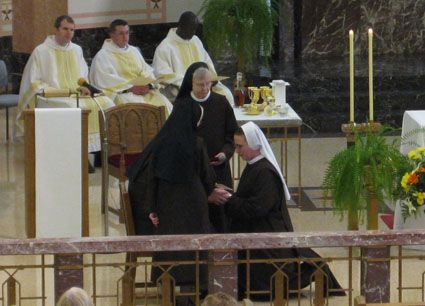 """Sister M Madeleine kneels before our Provincial Superior, Sr M Angela, and professes to live in obedience, poverty and chastity for three years: """"Trusting in the grace the Lord has given me . . ."""""""