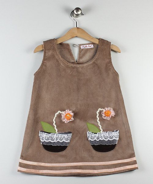 Fashioned with a playful appliqué, this corduroy dress is sure to delight your miniest miss. Style it with woolly tights and a classic pair of Mary-Janes for a super-sweet look.Please allow for extra days shipping over the Christmas period90% cotton / 10% elastane