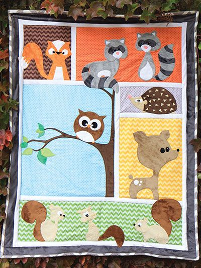 "Oh-so-cute pattern that will make you squeal with delight!   This precious pattern makes the absolutely perfect gift for any expectant parents and their soon-to-be-born baby! Fun and easy to make, this pattern has 6 block backgrounds and appliques for 9 delightful forest animals, includes a fox, 2 raccoons, 3 squirrels, a hedgehog, a deer and an owl. Pattern includes instructions for assembly and attaching the appliques, as well as full-size tracing guides for each applique. Finished size is 43"" x 56"".:"
