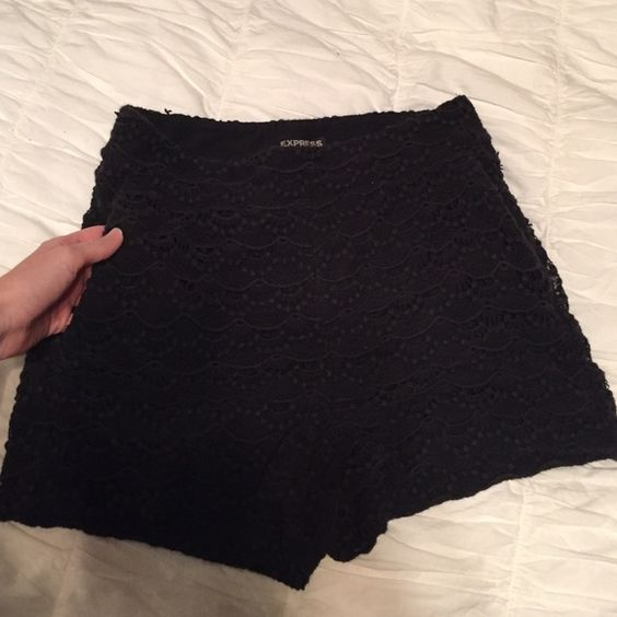 Black High-waisted Shorts Laced looking black shorts with pockets and zipper on the side. Worn but still look like new. Express Shorts