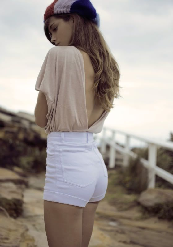 high waisted tight shorts and low back. Both old-fashioned and ...