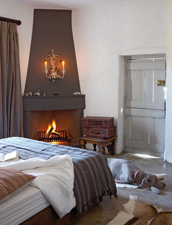 Like the scale of this fireplace...and of course the pooch.  Farmhouse, cottage style.