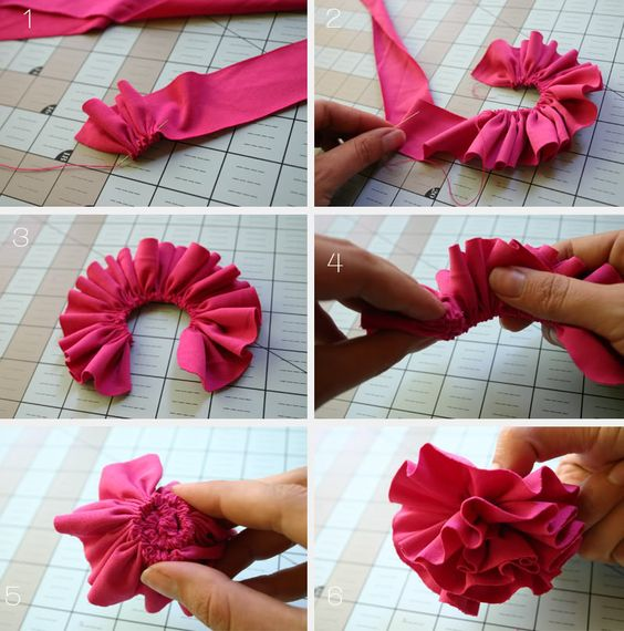 1- pass a needle in zig-zag thought the edge of your second piece of fabric.  2- secure the beginning and pass it all the way.  3- secure the end and round the corners.  4- roll the ruffle  5- pin it though to keep it safe.