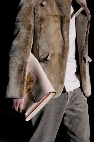 Nude leather clutch, fur jacket with leather buckles. all by Louis Vuitton. Mens fashion accessories style