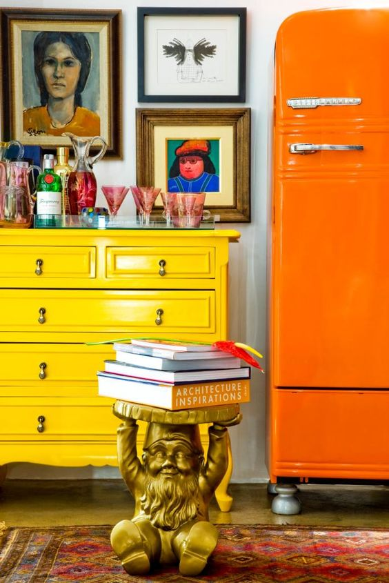bright yellow commode and bright orange retro fridge for a stylish cocktail area at home #yellow #bright #orange #home #interiordesign #decor #decorideas