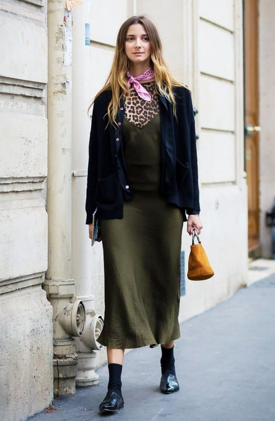 4. Style a green slip dress with forward accessories such as a silk scarf, mini bag, and backless loafers.