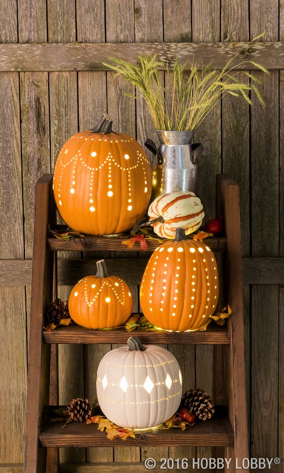 Get creative with carvable faux pumpkins and break outside the traditional jack-o'-lantern designs! Who knew pumpkins could be so glam?: