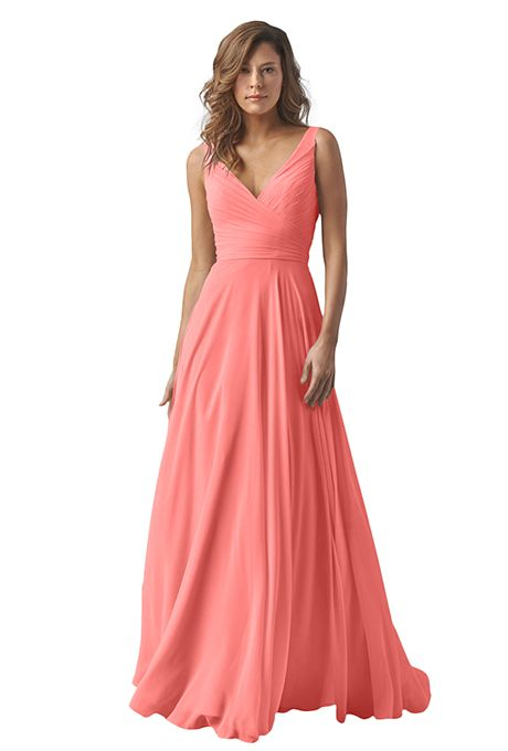 A coral-colored Watters crinkle chiffon bridesmaid dress with a shirred crisscross bodice and sash   Brides.com