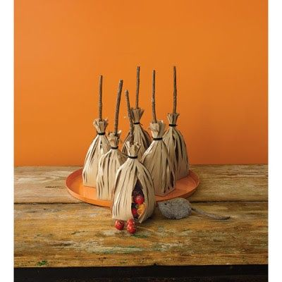 Halloween Broom Stick Favors made from paper bags. Cut paper bags in strips, fill with treats, use sticks as broomstick and tie top with yarn.
