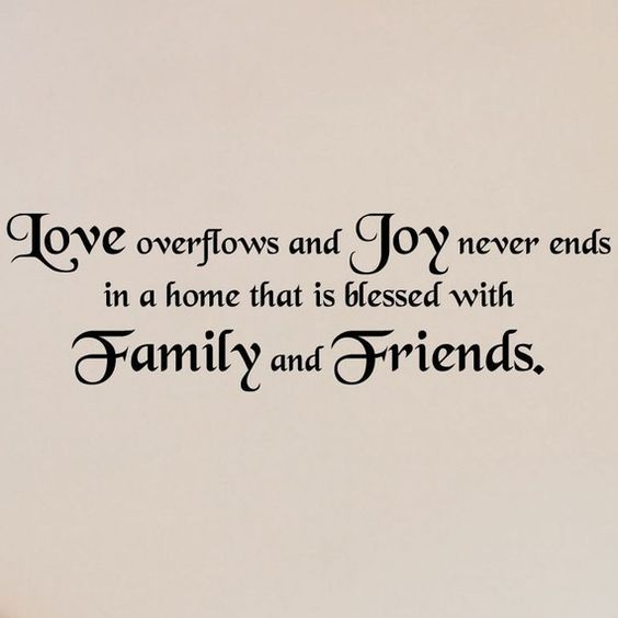 Love overflows and joy never ends in a home that is blessed with family and friends vinyl lettering wall saying 10x34