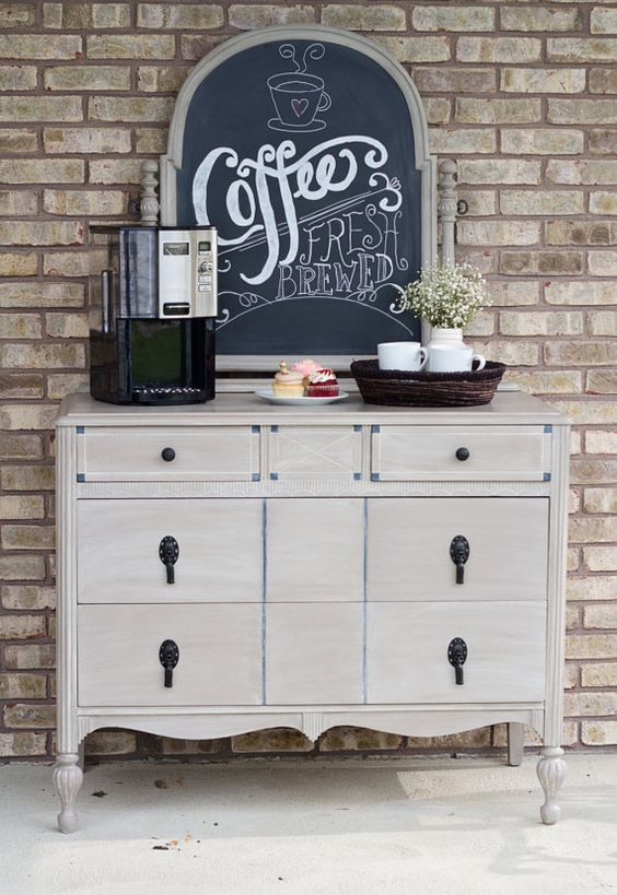 "Why not entertain your friends and family with the ultimate vintage coffee bar? Upcycled vintage dresser turned into a coffee station with 2 large and 2 small drawers with lots of storage for coffee pods, sugar, packets of creamer etc. Painted with Annie Sloan Chalk paint in 'Cocoa "" and an added wash of "" Old Ochre "" to give it some wonderful dimension. The mirror was transformed into a chalkboard so you can add your favorite coffee sayings or seasonal greetings. It's all up to you! Coffee b..."