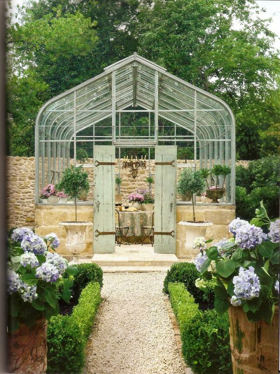 solarium w/ antique French limestone; Pamela Pierce  // Great Gardens & Ideas //