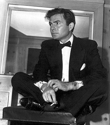 James Mason, I love his voice...he could read the phone book and it would sound interesting.