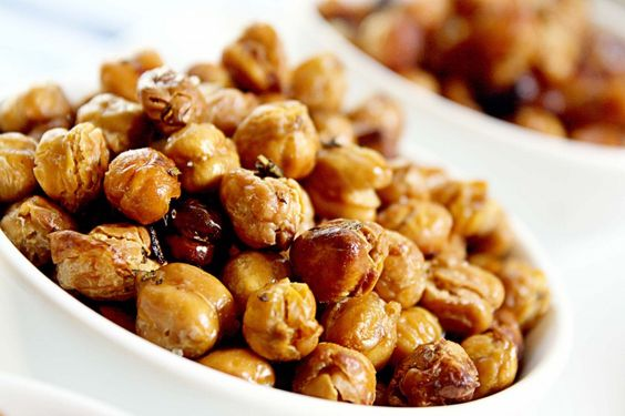 Simple, crunchy, and seriously addictive Roasted Chickpeas. Sriracha, Lime, and Cilantro; Sea Salt and Rosemary; and Honey Roasted Chickpeas #recipes #kidSnacks #chickpeas