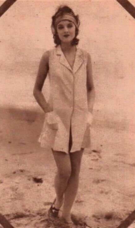 A young Myrna Loy. Love this sleeveless shirt dress look.