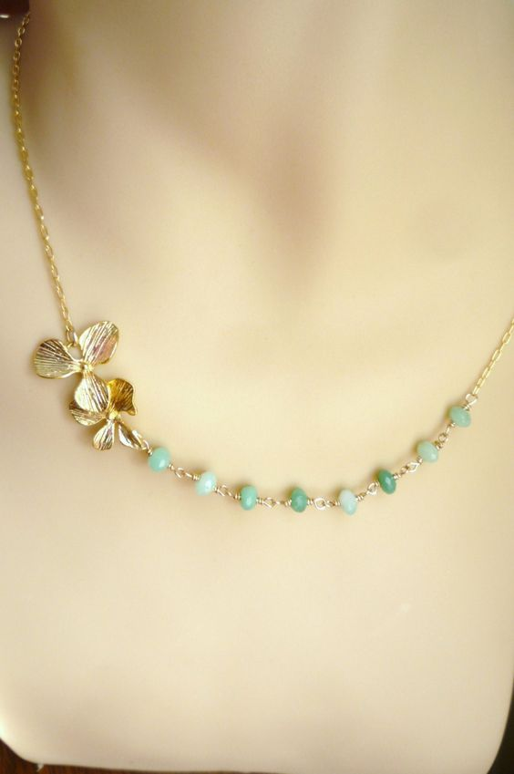 Gold flower and chrysophrase necklace. Flower and green necklace, gold necklace, gold flower necklace, green necklace. $42.00, via Etsy.