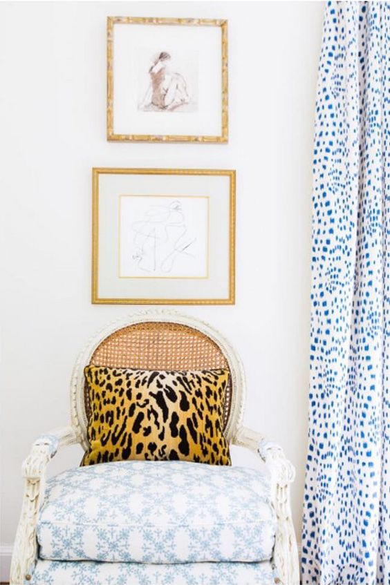 Blue bedroom classic decor by Sarah Bartholomew. Bartholomew made curtains, a headboard, and a bed skirt from Les Touches, a versatile 1965 Brunschwig & Fils print. She's undeniably on a quest to find traditional things with a modern aspect, and this classic snow leopard print filled the bill. White sheets with a green scalloped edge indeed provide a cheery contrast on the bed.