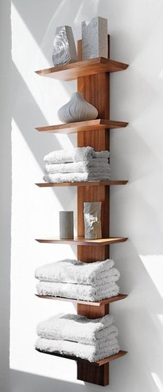 Awesome towel storage for small spaces with this wall mounted spine shelf.