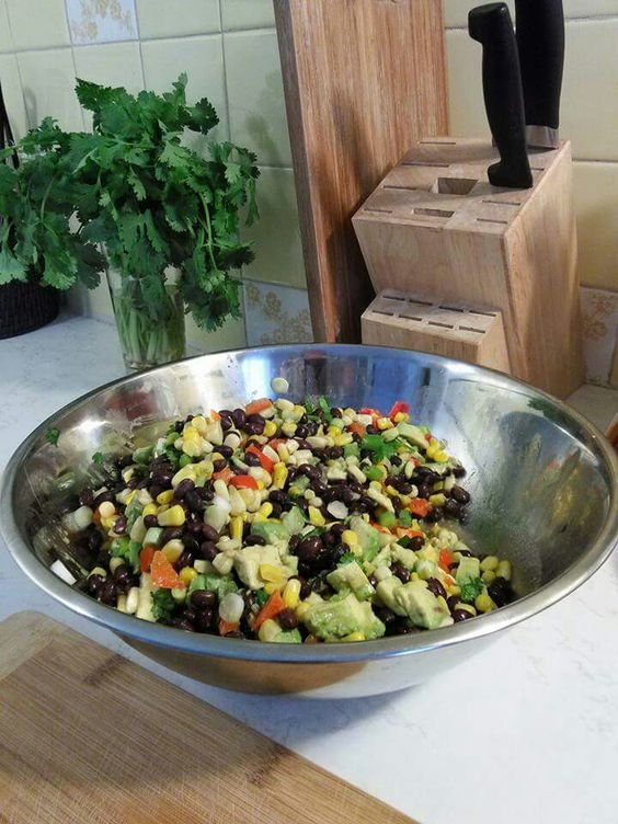 Black bean salad.  Its basically 2 cans each; black beans and corn, a child's size handful of fresh cilantro, a diced red pepper ,  3 avocados diced,  and one diced onion ( I used green onions since they're milder and my kids prefer them.) Add lime juice until everything's all wet and limey, then salt and pepper to taste.