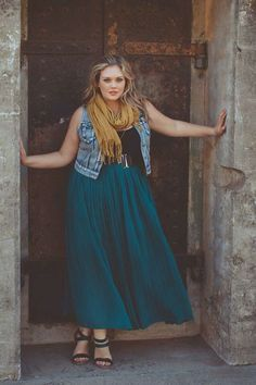 Plus size fashion for women. Full maxi, worn empire waist with a belt, denim vest and neutral tee