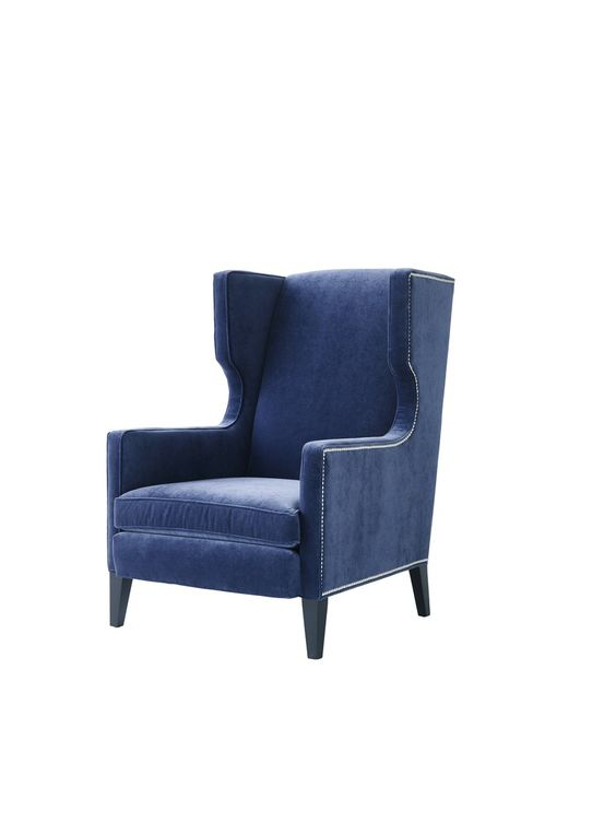 """MN: This has a clubby elegance. While it's a fairly classic wing chair, it's been given some modern twists, like the squared-off wings. It has a good scale, and it's sculptural. I would use it for younger clients. PN: The shiny silver nailheads and the intense blue of the velvet give this a glam quality. It's got some nice geometry to it and a beautiful profile. It has presence. $2,170; 32"""" w. x 37"""" d. x 45"""" h.; mgbwhome.com   - ELLEDecor.com"""